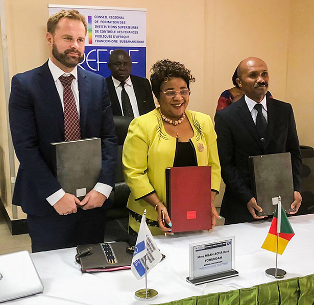 Signing ceremony with representatives from IDI, CREFIAF, and SAI Madagascar